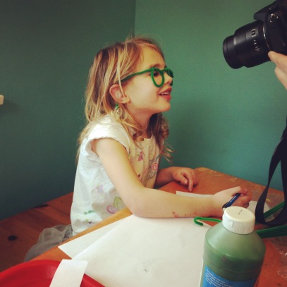 One of the willing participants in green pipe cleaner glasses