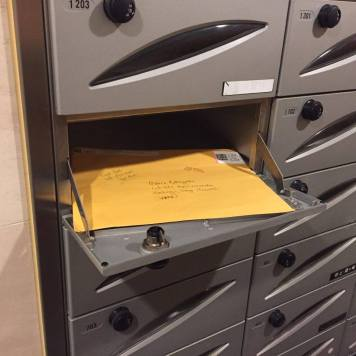 In the Japanese mailbox. (Q says it looks strange, indeed.)